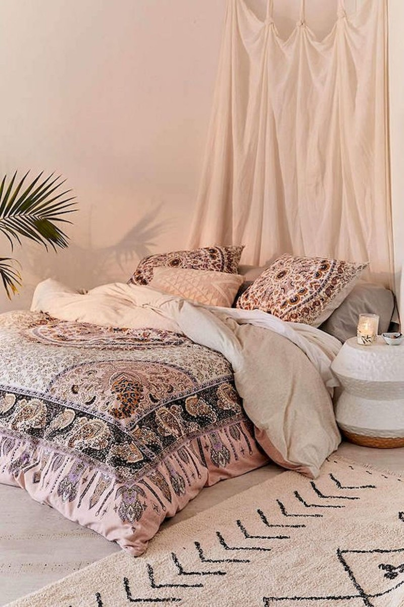ethnic pattern comforter Moroccan style bedside table white area rug with tribal patterns in black ornate drapery in white