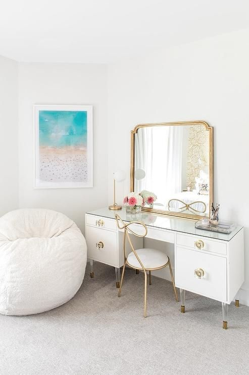 fancy makeup corner with white makeup table accentuated with gold framed mirror beautiful chair with gold legs and backrest white beanbag