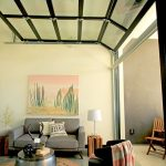 Garage Conversion Into Living Room Gray Sectional Sofa Metal Coffee Table With Round Top Round Shaped Flat Woven Rug