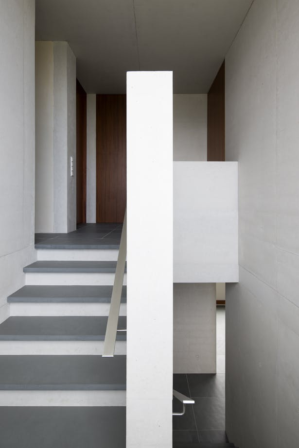 interior staircase with metal handle in modern minimalist style
