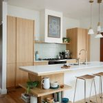 Light And Airy Kitchen Design Natural Wood Cabinets Light Green Tile Backsplash White Top Kitchen Island Modern Bar Stools With Wood Top
