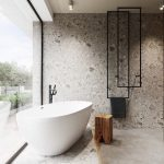Master Bathroom Design With Textured Walls Modern White Bathtub Wood Stool Concrete Tile Floors Black Piping Installation