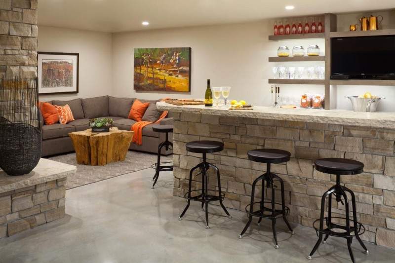 mini bar and living room in the basement
