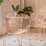 Minimalist Brass Dining Chairs With Hairpin Legs White Area Rug With Tassels And Black Patterns