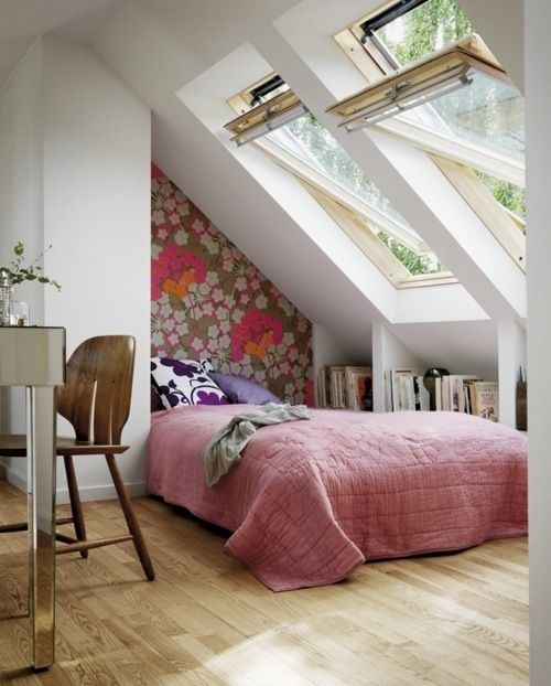 modern attic bedroom with pink duvet cover fabulous wallpaper skylights wood floors