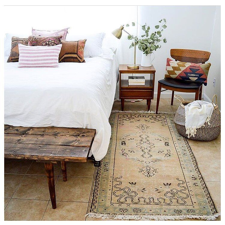 modern bedroom with white bedding treatment rustic style bench bed worn out runner dark wood bedside table