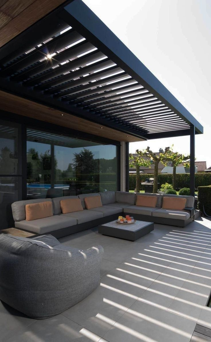 modern minimalist terrace with L shaped sectional sofa in gray tan schemed throw pillows