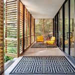 Screened Terrace In Modern Style Modern Area Rugs In Black White A Couple Of Midcentury Modern Chairs With Yellow Cushion And Wood Frame
