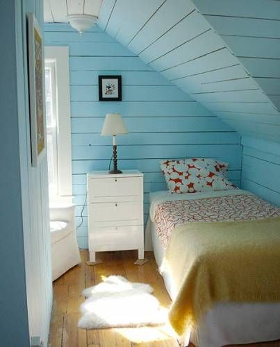 small attic bedroom design with single bed frame white dresser multicolored bedding treatment light blue wood plank ceilings and walls