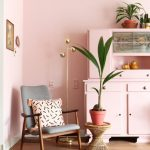 Soft Blush Pink Storage Idea Midcentury Modern Chair With Soft Pink Accent Pillow Woven Side Table For Houseplant Wood Floors Soft Blush Pink Walls
