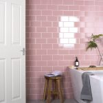 Soft Blush Pink Subway Tile Walls Wood Stool Modern White Bathtub Some Greenery