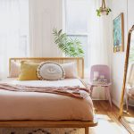 Soft Toned And Minimalist Bedroom Light Wood Bed Frame With Headboard Light Purple Chair White Draperies White Area Rug