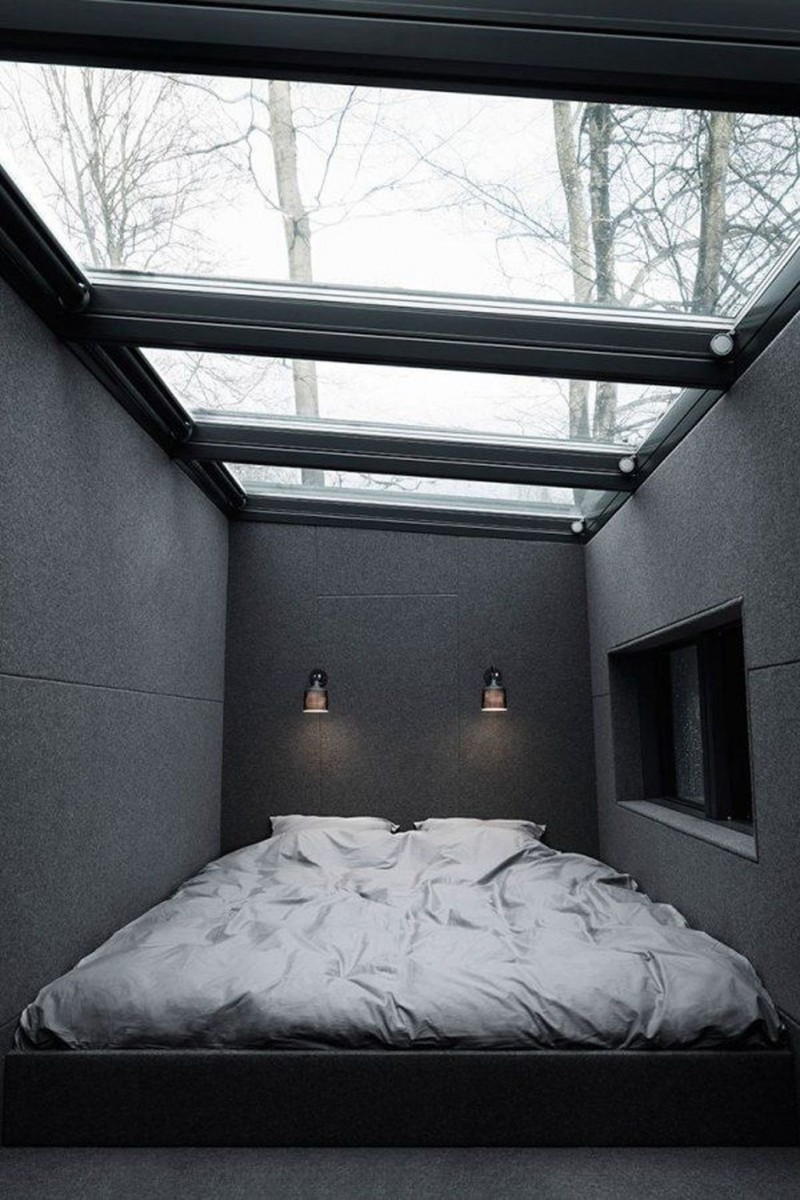 tiny bedroom design in black dominance a couple wall lamps glass skylight with trims
