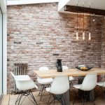Ultra Light Brick Wall Midcentury Modern Dining Furniture Consisting Of White Dining Chairs And Wood Dining Table