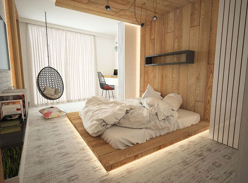 ultra modern bedroom idea with hidden lighting under wood platform bed egg hanging chair simple modern shelving unit in black