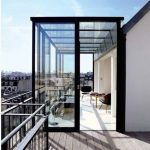 Ultra Modern Screened Terrace With Black Framed Glass Screen And Black Metal Railings