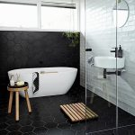 White Black Scandinavian Bathroom With Hexagon Black Tile Walls And Floors White Bathtub Black And Round Top Stool With Wood Legs Wall Mounted Sink In White