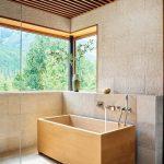 Zen Feel Modern Master Bathroom Design With Rectangular Shaped Wood Bathtub Hard Texture Concrete Walls Frameless Glass Windows
