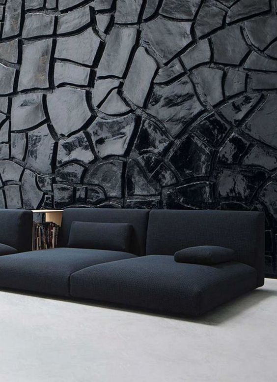 barren soil like wallpaper in glossy black modern floor cushions in black