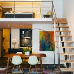 Contemporary Loft Design With Natural Wood Staircase With Metal Railing System Scandinavian Style Dining Furniture Colorful Modern Area Rug