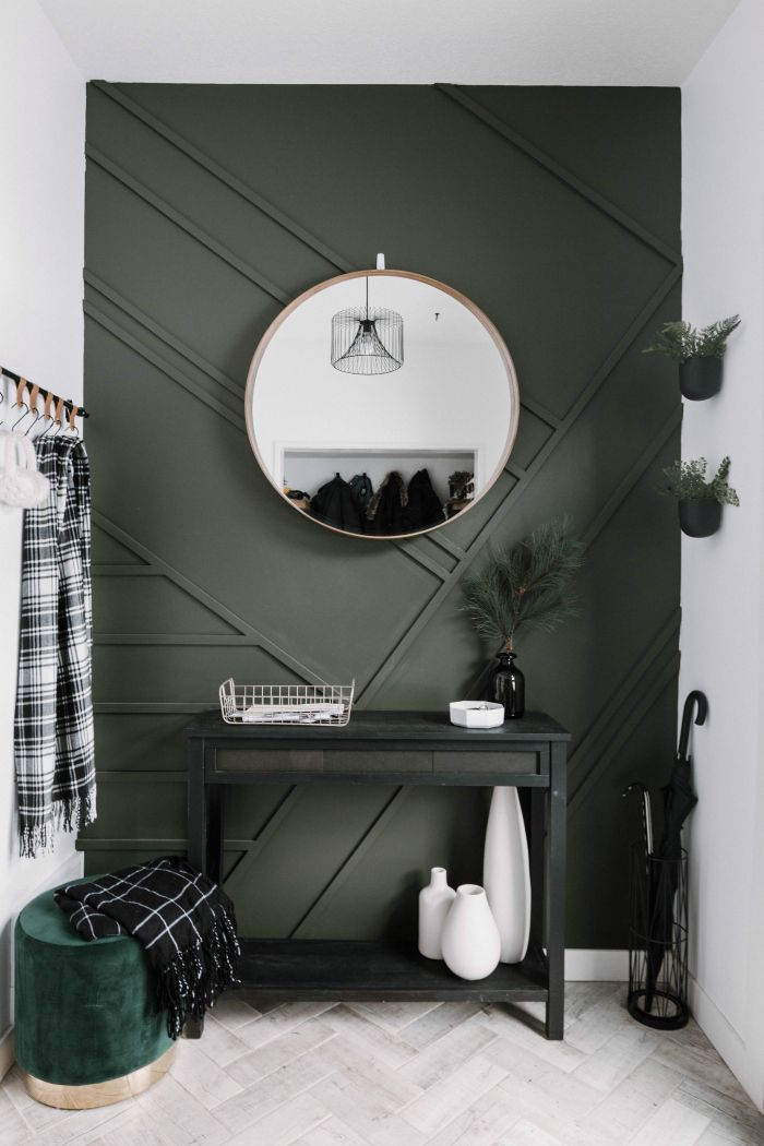 emerald green walls black console table green velvet stool whitewashed herringbone tile floors