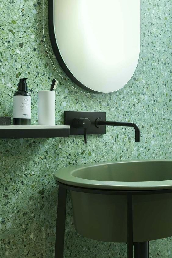 green terrazzo walls standing bathroom vanity with green sink