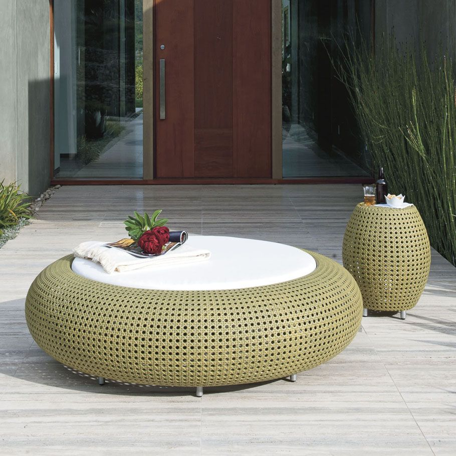 handwoven capsule outdoor daybed with round cushion in white handwoven side table with metal legs