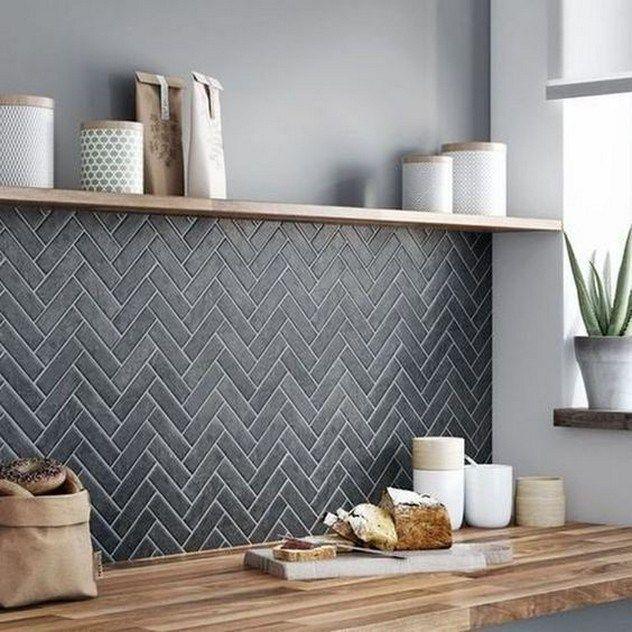 matte black herringbone tile backsplash with white grouts