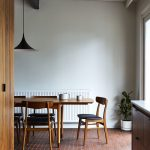 Midcentury Modern Dining Space With Midcentury Modern Dining Furniture Set Dark Red Tiled Floors White Walls With Baseboard