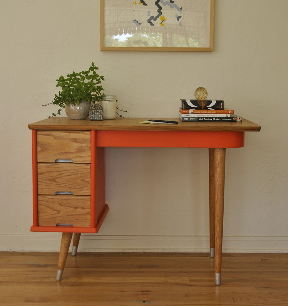 midcentury modern working desk with orange highlight