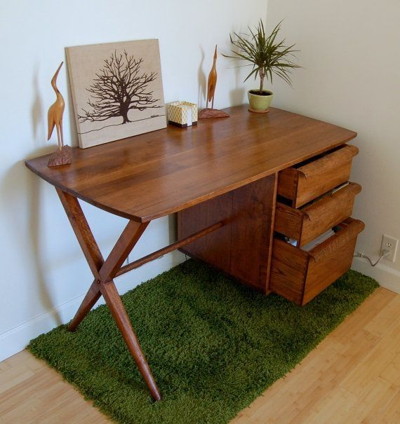 midcentury modern working desk with series of drawers and x base legs