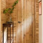 Minimalist Yet Stylish Entryway Dominated By Natural Wooden High Profile Hallway Console With Minimal Greenery On Clear Glass Pot