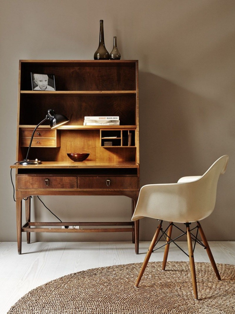 natural wood working desk with multi storage space midcentury modern chair in white and with angled legs