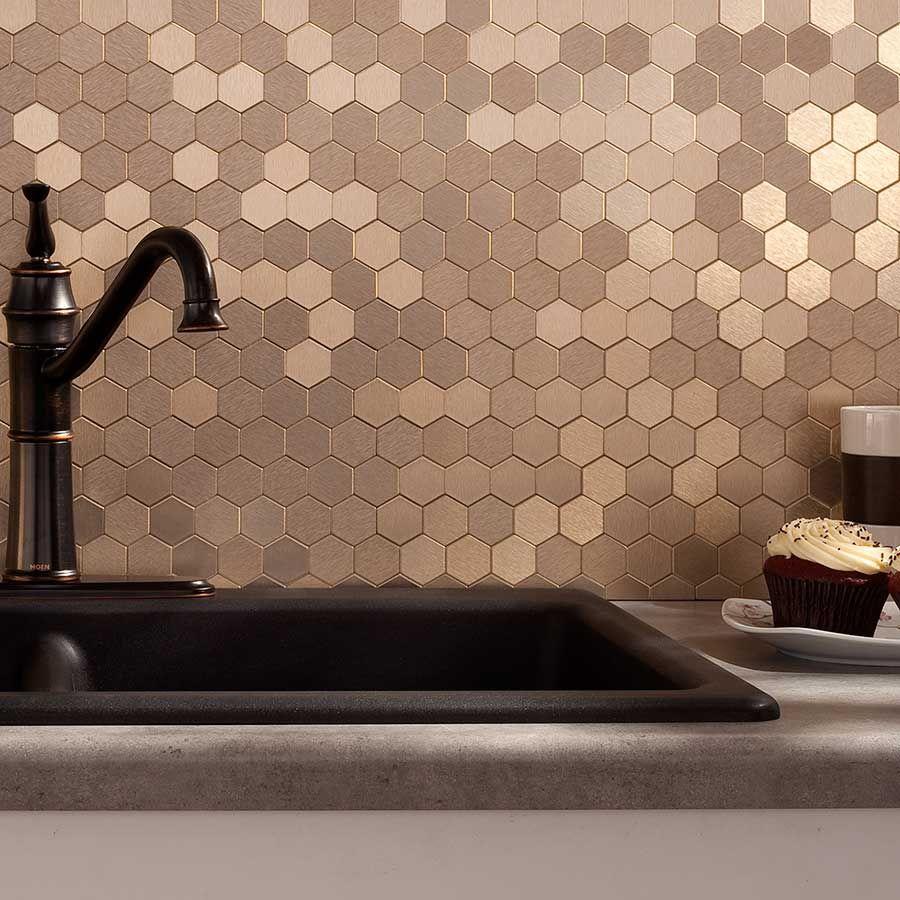 shimmering herringbone tile backsplash