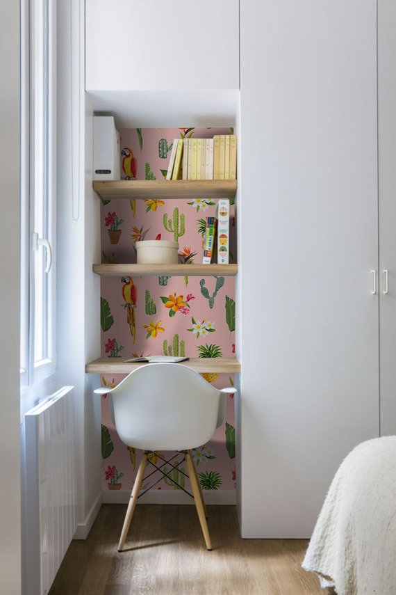 small workspace with parrot tropical wallpaper Scandinavian style chair small wood table wood open shelves