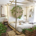 Bohemian Bedroom With Bed Tree Canopy Plus String Lamps Wall Art With Green Vines Growing Greenery On Crates