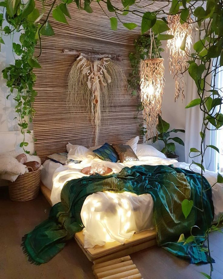 Boho style bedroom with wood partition as the headboard green vines decoration white bedding set blue throw blanket