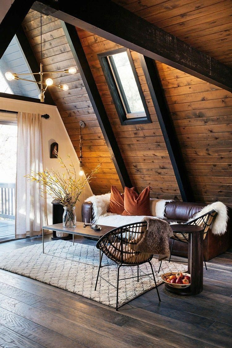 Boho style interior for cabin with dark brown leather sofa minimalist coffee table with dark wood top Scandinavian style area rug white shag throw blanket