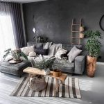 Wabi Sabi Living Room Design With Dark Gray Walls Dark Gray Sectional Sofa Stripe Rug Ornate Ladder Rack Wooden Planter With Greenery