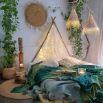 Adorable Boho Style Bedroom With Tree Branch Pointed Headboard Platform Bed Frame Blue Green Blanket With Pompoms Flat Woven Rug In Round Shape Greenery
