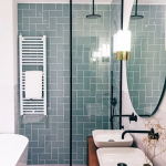 Adorable Industrial Bathroom Idea With Aquatic Shade Subway Tile Walls Clear Glass Shower Partition With Black Frames Double White Sinks On Wooden Bathroom Vanity Frameless Round Mirror