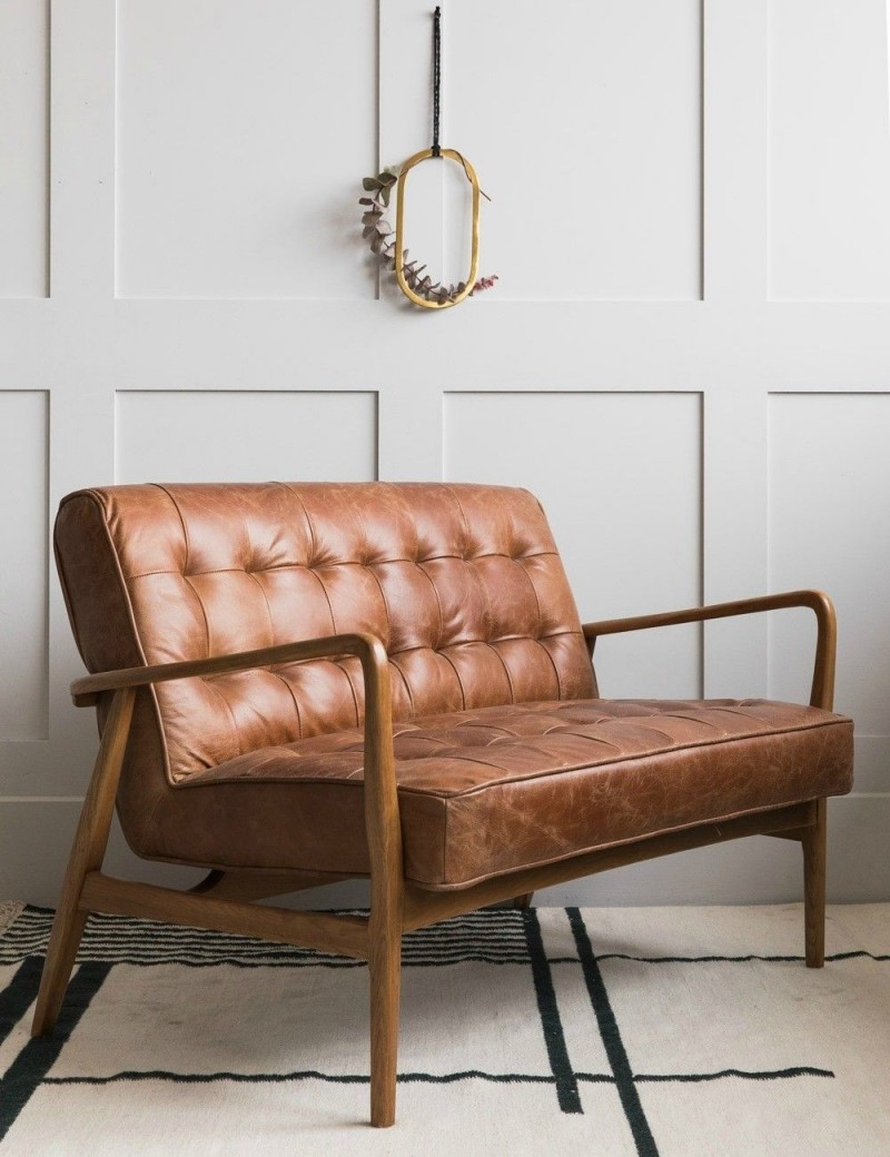 brown leather two seater in midcentury style