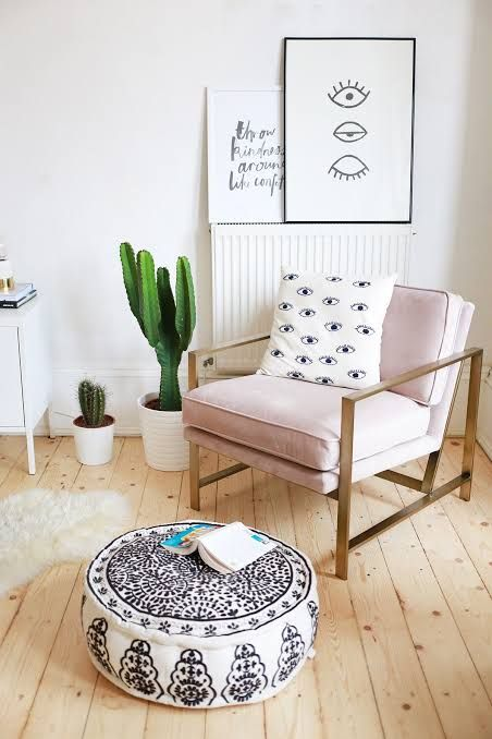 chic minimalist sitting corner in Bohemian style pastel corner chair with metal frame Moroccan footrest light wood floors white shag mat
