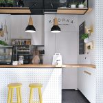 Coffee Shop Inspired Kitchen Station With Wood Top Coffee Station Yellow Stools With Round Wood Top Black Subway Tile Floors With White Grouts