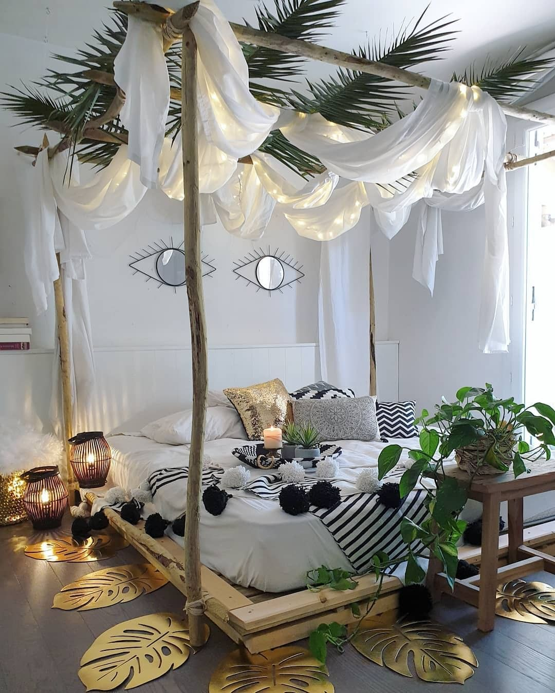 cool Bohemian bedroom idea with bed frame with bed canopy and white curtains vivid greenery ornate Boho style floor light fixtures