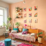 Cool Color Boho Style Sitting Area With Simple Daybed With Boho Cloth Cover Wooden Console Table Light Orange Walls With Lots Of Wall Arts Some Greenery On Pots Colorful Area Rug