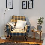 Corner Chair In Gray Yellow White Throw Pillow Throw Blanket Gray Sheep Skin Rug Modern Floor Lamp Round Top Wood Side Table