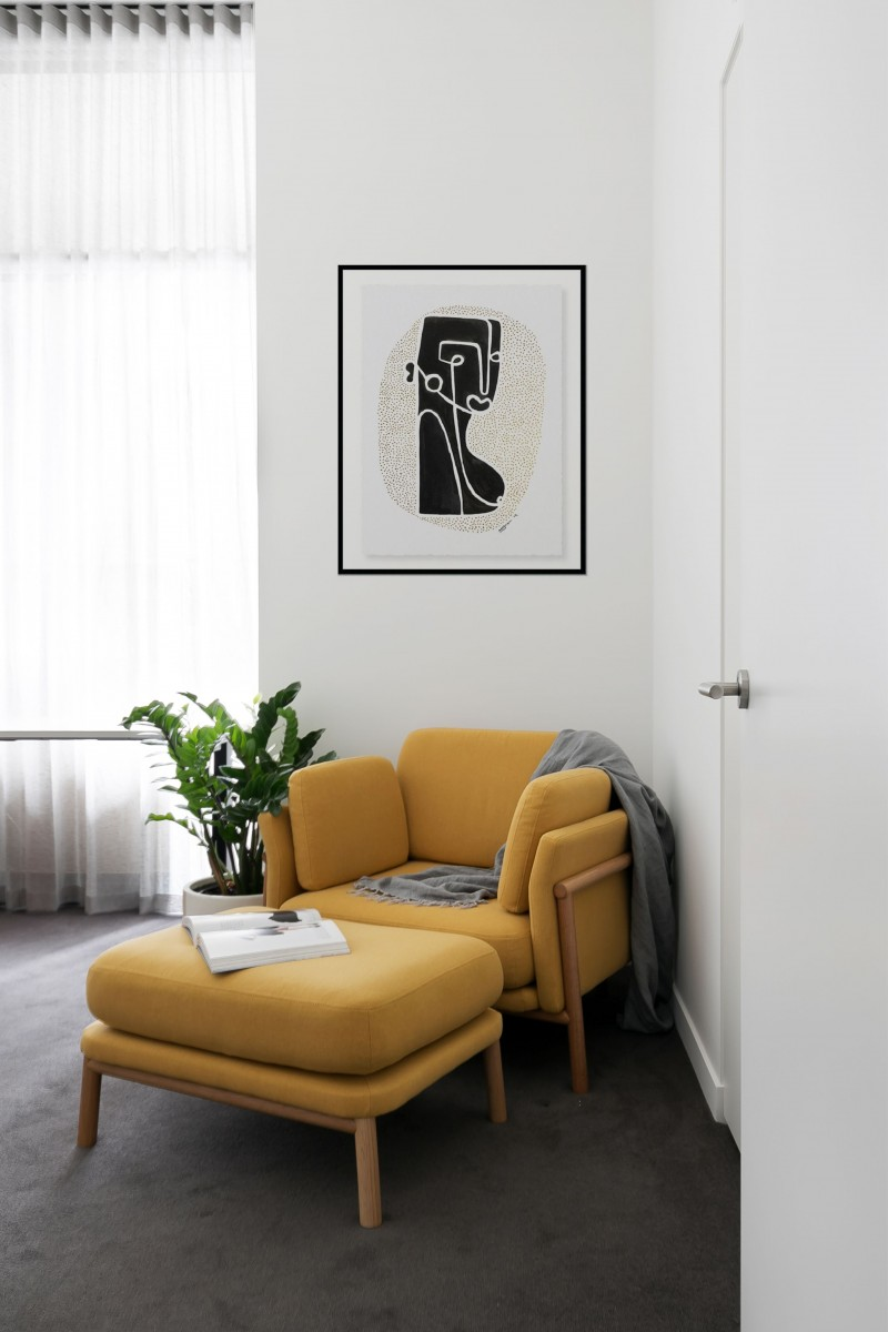 corner sitting area with yellow chair yellow footrest