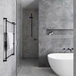 Elegant Bathroom Inspiration With Gray Marble Like Walls And Floors Black Metal Hardware Modern White Bathtub