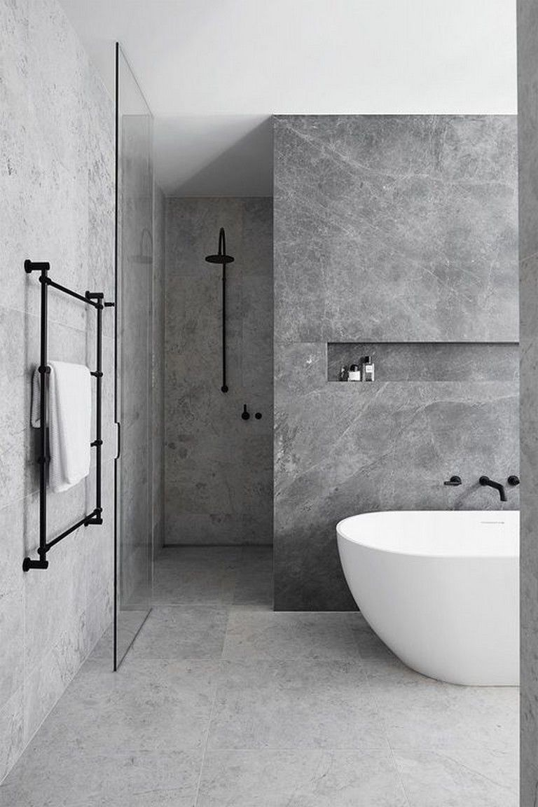 elegant bathroom inspiration with gray marble like walls and floors black metal hardware modern white bathtub